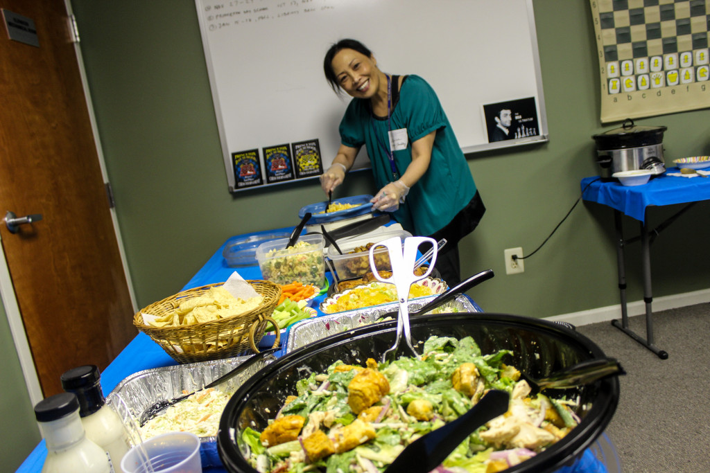 Monica serves up some yummy catered food